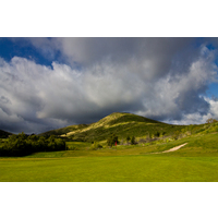 A dramatic cloud hangs over Mt. Miguel on the 12th hole at Salt Creek Golf Club.