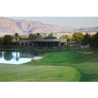 Glen Ivy Golf Club's 16th hole is a par 4 dogleg right to a green, protected by water and two sand bunkers.