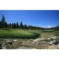 The 18th hole at Grizzly Ranch Golf Club is an uphill par 5 guarded by water.