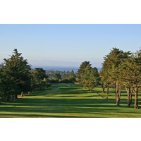 The first hole at Pasatiempo Golf Club heads downhill with the ocean in the background.