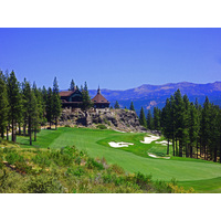 Martis Camp's magnificent clubhouse provides the backdrop for the Tom Fazio golf course's finishing hole.