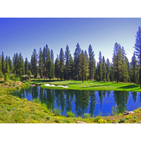 Martis Camp's par-3 third plays from an elevated tee over water. Left is probably double bogey or worse.