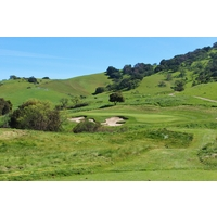 The par-3 16th hole is one of the many pretty settings on the back nine at San Juan Oaks Golf Club in Hollister.