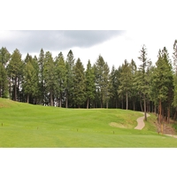 After a semi-blind tee shot, the 14th hole at Apple Mountain Golf Resort trudges uphill.