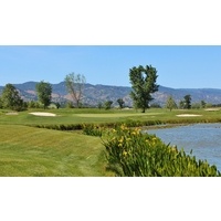 Flowers bloom along the pond near the par-3 fourth hole at Yocha Dehe Golf Club at Cache Creek resort.