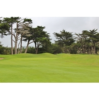 Mounds constrict the entry point to the 12th green on the Old Course at Half Moon Bay Golf Links.