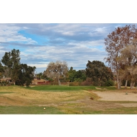 The green grass surrounding the second green shows off the new overseeding practices at Carlton Oaks Golf Club in Santee, California.