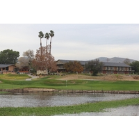 The finishing hole at Carlton Oaks Golf Club sits below the lodge (on the right) and pro shop/restaurant (on the left).
